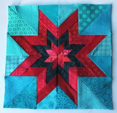 Paper peicing star block 13; block for table runner. Royal center, white, blue print. Rotate corners white star background with blue 'snowball' corners.