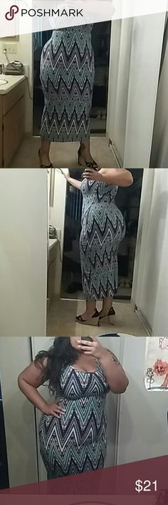 NEW Sexy Dress NWOT.. Beautiful multi-colored zig zag pattern (best seen in pic 6).. Much more beautiful in person.. Soft material.. Excellent stretch.. Tag says Lg... More like XL, 1X or 2X Dresses