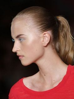 A model sports the slicked-back ponytail at DKNY. | allure.com