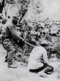 A Chinese POW about to be beheaded by a Japanese officer with a shin gunto during the Nanking Massacre