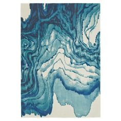 Lend a touch of visual appeal to your living room or master suite with this loomed rug, showcasing an abstract motif in a cool palette.   ...