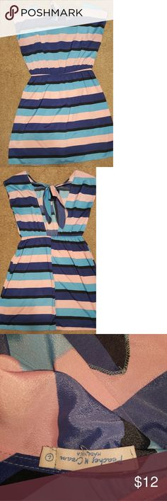 Dress Very cute dress that is 100% polyester. Good condition. The back of dress is open-back and ties at the top. Peaches N Cream Dresses Midi