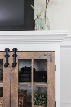 Farmhouse Media Cabinet - buildsomething.com Farmhouse Media Cabinets, Kitchen Base Cabinets, Diy Cabinets, Painted Furniture, Diy Furniture, Barn Door Tv Stand, Plywood Shelves, Fireplace Tv Stand, Moldings And Trim