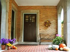 Sunny Portico      Sunny Portico    Adding an assortment of pumpkins, gourds and colorful mums to their Italiante villa's front entry brings a touch of all. A wrought-iron bench is a nice addition and gives the outdoor room a sit-a-spell feel.