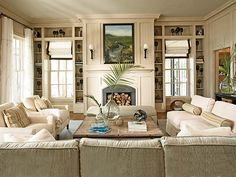 see the ottoman past the coffee table? i like that idea for the living room (granted if we do a tufted coffee table then we would not want two ottomans)