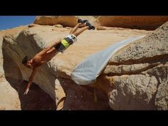 Watch These Guys Slip 'N Slide Off A 50 Foot-Cliff