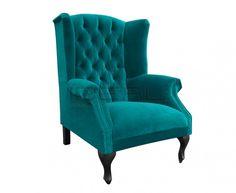 Chesterfield - Fotel Chesterfield Szerlok - Ideal Meble Przepiękny fotel Uszak w stylu Chestefield. Intensywny kolor pluszu podkreśla głęboko pikowane oparcie. Godziny z dobra książką przy kominku w tym fotelu to to o czym marzysz będąc w pracy.