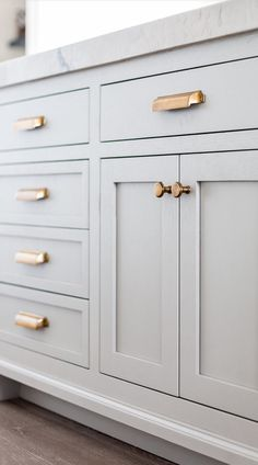 Love this soft grey shaker style cabinets with the gold pulls. Kitchen inspiration. home decor. interior decorating
