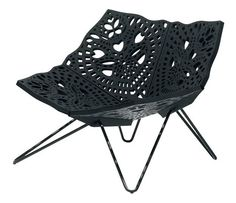 Perforated chair in black color - adding modern accents to interior design and decor
