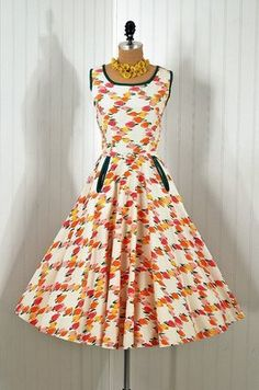 50's with what look like bound pockets and fun print.