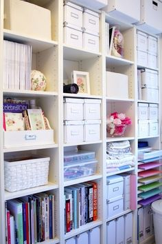 Organization ideas for office or craft room.  Neat and colorful bookshelf using white boxes, baskets, books, binders.