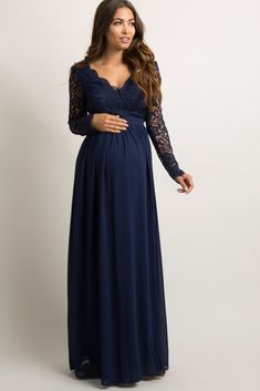 A solid hued maternity evening gown featuring a semi-sheer scalloped crochet top with long sleeves, a cutout back, and a deep v-neckline. Also features double lining on pleated chiffon skirt and bust, and a hidden hook and zipper back closure. Navy Blue Maternity Dress, Maternity Bridesmaid Dresses, Long Sleeve Maternity Dress, Pink Blush Maternity, Wedding Dresses, Formal Dresses, Maternity Evening Gowns, Baby Shower Dresses, Maternity Fashion