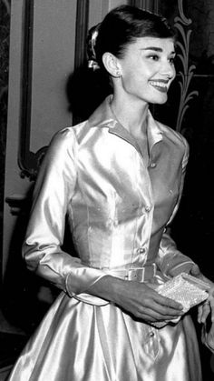 Audrey Hepburn at The Lido Nightclub in Paris,France-December 19,1955- De audrey and marilyn