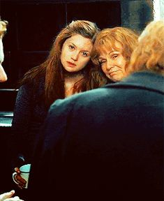 """""""He spotted Ginny two tables away; she was sitting with her head on her mother's shoulder: there would be time to talk later, hours and days and maybe years in which to talk."""" — Deathly Hallows, pg 745"""