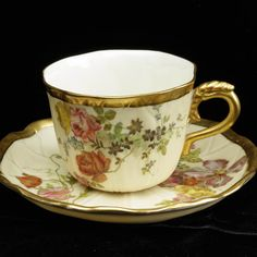 Cup and saucer A of Royal Worcester Royal Worcester 1895 year flowers