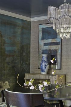Normandy Residence   Musso Design Group  Romantic Dining Room  Armani Wallpaper   Vintage Wedding Cake Chandelier  Cherry Blossoms  Distressed Antique Mirror