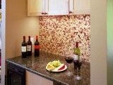 Cork backsplash in the kitchen.  hmmm, might look awesome.