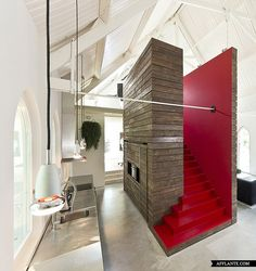 Awesome freestanding wood structure, built as stairs to loft while creating separation of kitchen and great room [former Church, now residence].