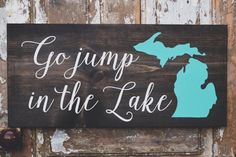Go Jump in the Lake Michigan Sign  Hand painted wood sign  Dark stain with white lettering. Michigan is painted a turquoise blue. If you are