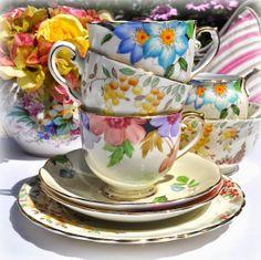 Colourful vintage teacups stack