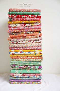 Quiltin' Gals: an awesome shop for 30's reproduction prints (stack of fabrics photo from NanaCompany: http://nanacompany.typepad.com/nanacompany/2013/03/let-the-spring-cleaning-begin.html)