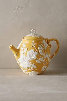 Petal Vines Teapot .. molded raised white flower and vine decoration on gold yellow body and lid, w/ vine wrapped handle & short spout, c. 2000s, handpainted stoneware