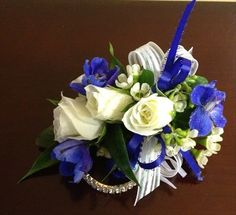 White Sweetheart Rose and Blue Delphinium Corsage for Prom by www.darlingflowers.net