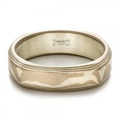 #100525 This handsome men's wedding ring features a squared band made of hand-forged mokume gane, with a sandblasted and lightly acid etched finish. It's a classy and...