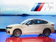 The BMW X4 M40i arrives onstage during the automaker's