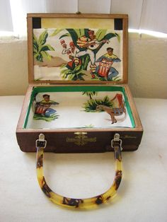 Cigar box purse made from Opus X box and lined with appropriate Carribean themed fabric. Cigar Box Purse, Altered Cigar Boxes, Cuban Art, Painted Boxes, Craft Day, Suitcases, Jelly Beans, Cigars, Recycling