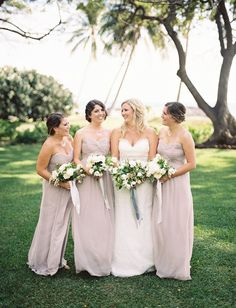 Bridesmaids in dusty blush dresses