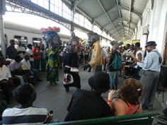 COMBOIO DA MARRABENTA    As part of the 5th Marrabenta festival (26 January- 12 February) on Thursday 2 February a train 'comboio da marrabenta' left to Marracuene for the Gwaza Muthini festival.     The party started off at Maputo's Caminhos de Ferro station with live music and a puppet dancing show.    After the show people got on the train to Marracuene. Visitors of the festival brought their own drums and started playing on the train during the journey, complete with girl's vocals and… Maputo, January 12, Puppet, Live Music, Drums, Colonial, Thursday, Dancing, Hold On