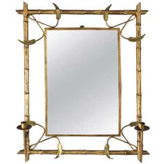 "Mid Century Gilded Metal Spanish Mirror with Candleholders A very original Mid Century Mirror from Spain with an open frame made of gilded metal. The faux-bamboo shaped frame features chiseled leaves and two candleholders. The mirror itself is 19.75"" high x 14"" wide."