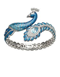 Fine Feathered Friend: A dazzling peacock bracelet created from enameled silver set with a sapphire, blue topaz, and white topaz.