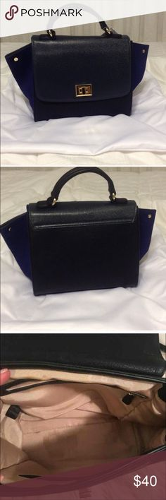 Izzy & Ali Trapeze Bag Izzy & Ali navy blue and black trapeze bag. Dresses up any outfit. Zara Bags Totes