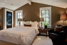 not fond of wall color, but I love the bed and that chair!! The trim is fantastic.