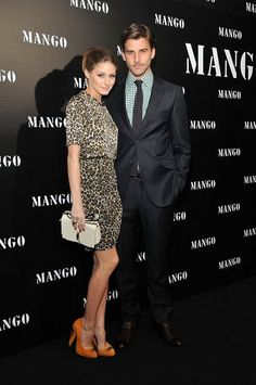 Olivia Palermo is cute as a button in this leopard print mini dress.