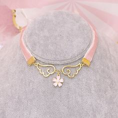 - Material: made of velvet and metal - Option: - Sakura choker - Shipping: Free Shipping Worldwide for order over 15$, 7-15 days delivery to US/UK/CA/AU/FR/DE/IT and most Asia Countries
