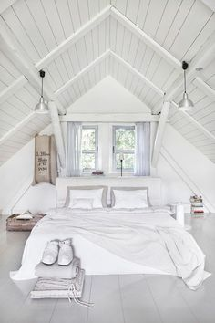 Contemporary Guest Bedroom with Hardwood floors, Exposed beam, Pendant light