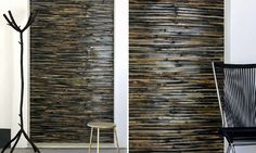 An horizontal collage of matt coloured  bamboo on a coloured lacquer background.         <br>
