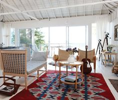 Scandinavian-Inspired Living Room  Used rugs and tapestries add texture, pattern and warmth.