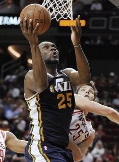 Utah Jazz's Al Jefferson shoots over Houston Rockets' Chandler Parsons