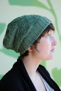 Ravelry: Gladys pattern by Melissa LaBarre    I think that stitch pattern is called Ostrich Plumes, or something like that. Maybe I'll make something like this soon.