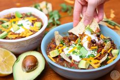 Crock Pot Black Bean Lentil Quinoa Chili is the most satisfyingcold weather cozy option! This vegetarian, healthy delicious chili can easily be made vegan.