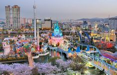 "Lotte World is a major recreation complex in Seoul, South Korea. It consists of the world's largest indoor theme park (a Guinness World Record) which is open all year around, an outdoor amusement park called ""Magic Island"", an artificial island inside a lake linked bymonorail, shopping malls, a luxury hotel, a Korean folk museum, sports facilities, and movie theaters all in one place. Opened on July 12, 1989, Lotte World receives over 8 million visitors each year."