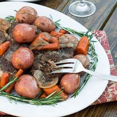 Tender and delicious Pot Roast with fresh rosemary.