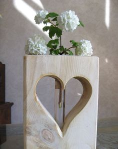 I got a lovely Mother's Day present. I have got a swiss wood heart with a flower from the garden. Isn't it lovely? The swiss wood smells w...