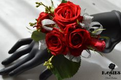 Red spray rose wristlets with silver ribbon for mothers and grandmothers for a red rose wedding! Flowers and Photograph by Rosie's Floral Boutique #corsage #red #roses #wedding #mob #mog #grandmothers #wedding