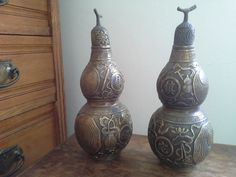 Pair of Chinese or Japanese bronze double gourd lidded pots available from Mallingbournes