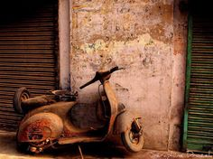 Grubby little rusty Vespa.  We love it!